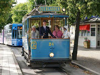 "Djurgårdslinjen - Djurgårdslinjen tram wagon 24, built 1904, at station ""Djurgårdsbron""."