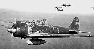 Hiroyoshi Nishizawa - Hiroyoshi Nishizawa in his Mitsubishi Zero A6M3 Model 22 (tail code UI-105) from the 251st Kōkūtai over the Solomon Islands in May 1943. The unit's aircraft have been hastily sprayed with dark green camouflage paint on the upper surfaces.