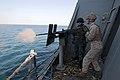 A Marine fires a .50-caliber machine gun. (6852046511).jpg