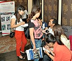 A beneficiary of USAID HIV Workplace Project talk to reporters on the sidelines of the event. (9092284420).jpg