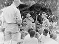 A gathering of men in uniform and Pacific island people (AM 76942-1).jpg