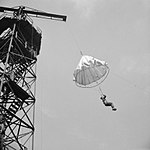 A recruit jumps from a tower during parachute training at Chesterfield in Derbyshire, 17 September 1942. H22994.jpg