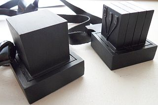 Tefillin small black leather boxes containing scrolls of parchment inscribed with verses from the Torah, worn by male observant Jews during weekday morning prayers