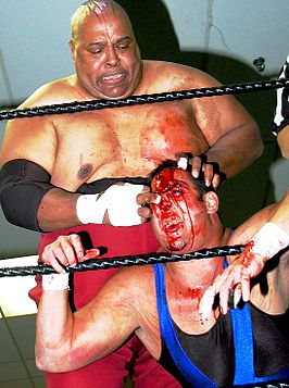 Als Abdullah the Butcher (boven) in 2004