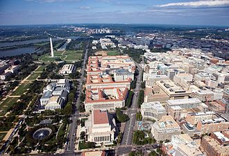 Constitution Avenue - Constitution Avenue NW runs vertically through the left-center of this image, forming the north boundary of the National Mall and the south edge of Federal Triangle (the structures with red roofs).