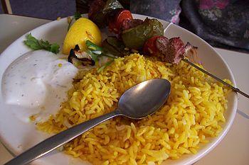 Afghani lamb kebab with yellow rice.