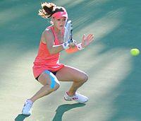 Radwańska hitting a crouching forehand.