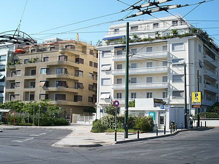 Two apartment buildings in central Athens. The left one is a modernist building of the 1930s, while the right one was built in the 1950s. Aigyptou Square Athens.JPG