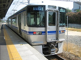 train that runs back and forth between two points, especially if it offers a frequent service over a short route
