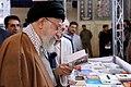 Ali Khamenei reading Ahmad Shamlu at the 32nd Tehran book fair.jpg