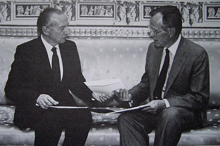 Before taking office, an ambassador's credentials must be accepted, such as when South African Ambassador Harry Schwarz handed his credentials to U.S. President George H. W. Bush in 1991. AmbassadorSchwarz,Bush.jpg