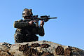 An Afghan National Army commando with the 1st Tolai, 6th Special Operations Kandak surveys an area for suspicious activity during a patrol in the Bati Kot district, Nangarhar province, Afghanistan, Jan. 10 140110-A-CL980-143.jpg