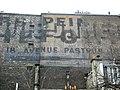 Anciennes publicités murales superposées formant un palimpseste, Avenue Pasteur, Paris.jpg