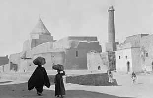 Ancient Mosul, a Yezidi shrine to the left and the Nouri Mosque minaret to the right.jpg