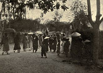 Traditional Vietnamese wedding - A wedding in Annam (Middle of Vietnam) in 1900s. The bridegroom's family was going to bride's house to ask her parents to take her home, a traditional process of Vietnamese people.