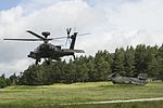 Apache Attack Helicopter (with 18 Sqn RAF Chinook on the ground) from 4 Regiment Air Air Corps Taking of for mission tasking over Hohenfels Training Area. MOD 45160071.jpg
