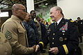 Army Gen. Martin E. Dempsey, right, chairman of the Joint Chiefs of Staff, greets a Marine during a Commitment to Service event where service members and players from the National Basketball Association's Brook 141106-D-KC128-0287.jpg