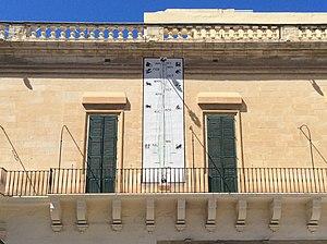 Casa del Commun Tesoro - The façade of the Casa del Commun Tesoro, with the sundial/calendar