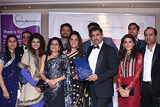 British Asian - An Asian business leader showcasing his awards at the Grange Hotel in London.