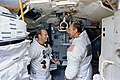 Astronauts Pete Conrad (on left) and Alan Bean are shown in the Apollo Lunar Module Mission Simulator.jpg