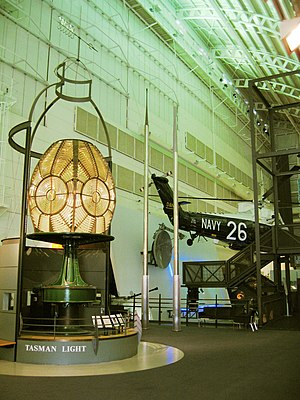 Australian National Maritime Museum - The original lenses from the Tasman Island Lighthouse; centrepiece of the Tasman Light Gallery. The Westland Wessex helicopter in the background is suspended above the Navy Gallery