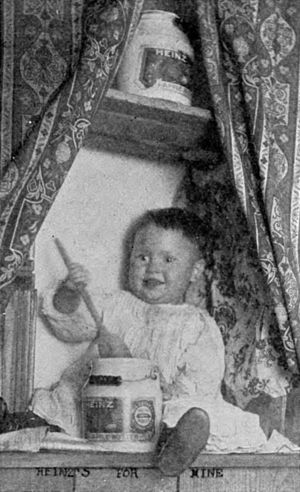 "Alaska–Yukon–Pacific Exposition - Baby eating Heinz apple butter and smiling, from an H. J. Heinz promotional pamphlet. Originally labelled ""PLEASED WITH THE GOODS."""