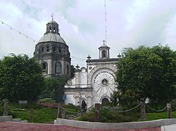 The half-buried San Guillermo parish church of Bacolor