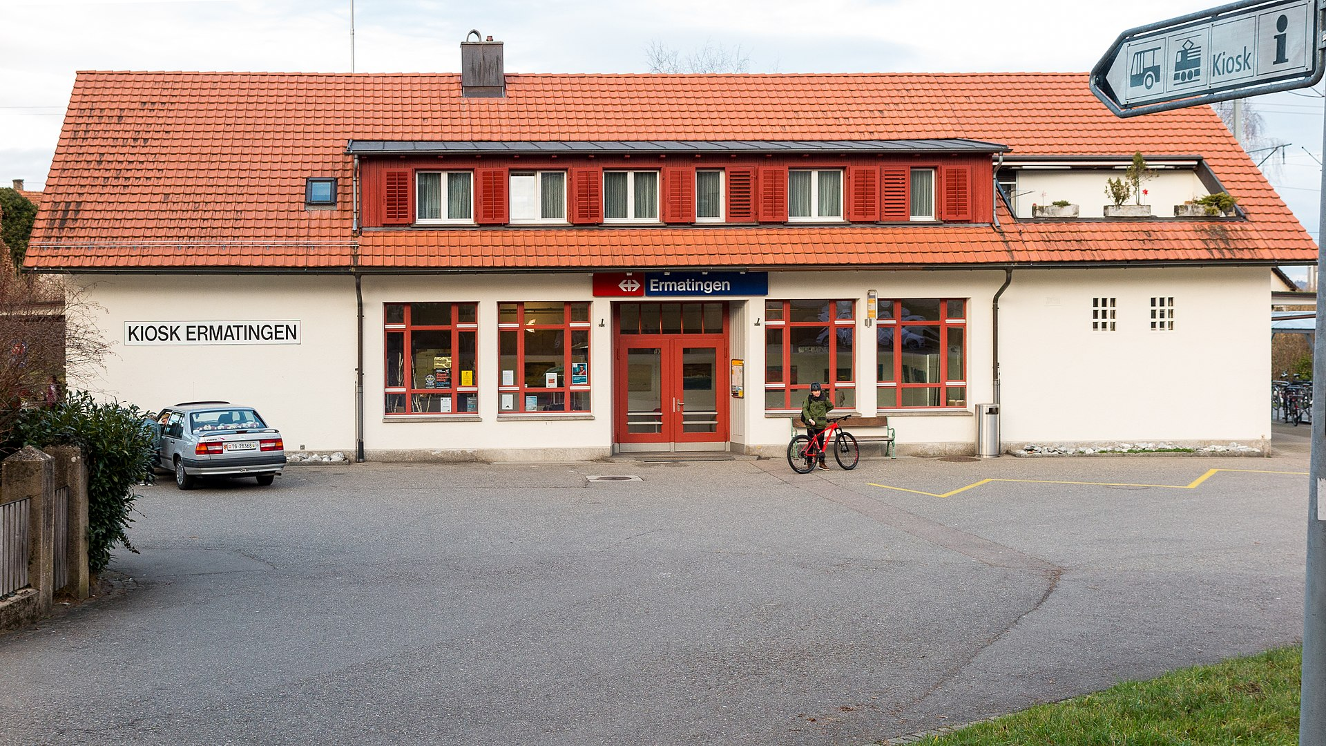 White building with red tiled roof