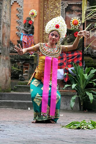 Folk dance - Balinese temple dancer performing Sekar Jepun dance in Bali, Indonesia