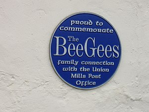 Union Mills - Bee Gees plaque at the Strang Road/Maitland Terrace (A1) intersection in Union Mills.