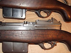 FN Model 1949 - Two FN-49 rifles from Belgian Army (ABL) contract. Upper weapon has no selective fire lever fitted, Lower weapon shows selective fire lever in Fully Automatic position.