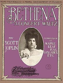 The 1905 front cover of the sheet music shows the title of the work, Bethena, in white lettering on a purple background. In the centre there is a black and white photograph of a young woman wearing white, holding a bunch of flowers.