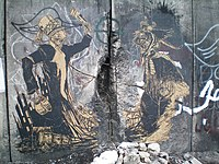 Bethlehem wall graffiti - Swoon - with two fighting figures.jpeg