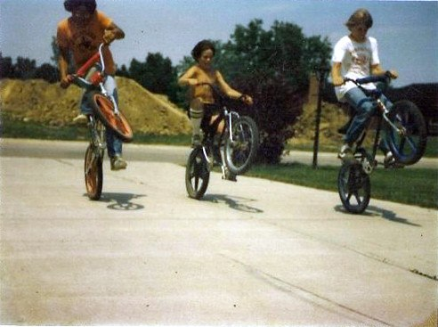 Children cycling during summer