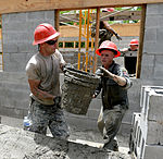 Bond beam work at Gabriela Mistral School construction site 150622-F-LP903-443.jpg