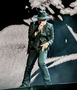 """Exit (U2 song) - Bono portraying a character called the """"Shadow Man"""" during a performance of """"Exit"""" on the Joshua Tree Tour 2017"""
