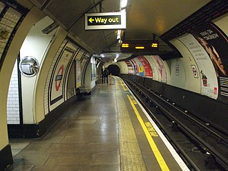 Borough tube station - Southbound platform, looking north. This platform is directly below the northbound platform. It is only accessible via a narrow flight of stairs as stated. The arch of the exit passage is almost entirely hidden by modern panelling