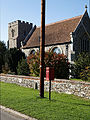 Box and pole and church Little Easton Essex England.jpg