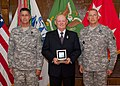 Brig. Gen. David Phillips and Command Sgt. Maj. Charles Kirkland present the 2011 Military Police Corps Regimental Hall of Fame award to retired Command Sgt. Maj. James R. Armour at Fort Leonardwood, Mo., 14 110914-A-WN220-971.jpg