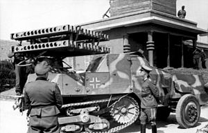 Alfred Becker - Becker stands by during presentation of one of his Vielfachwerfers, mounted on an armourized French SOMUA MCG.