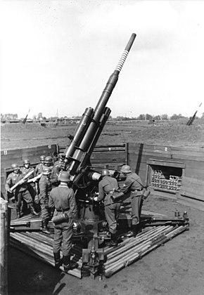 German 88 mm flak gun in action against allied bombers