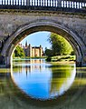 Burghley House on sunny day with bridge.jpg