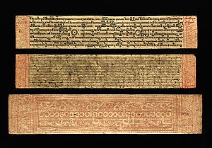 Buddhist texts - Burmese-Pali manuscript copy of the Buddhist text Mahaniddesa, showing three different types of Burmese script, (top) medium square, (centre) round and (bottom) outline round in red lacquer from the inside of one of the gilded covers