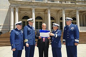 United States Coast Guard Auxiliary - Active Duty Coast Guard personnel (left), and Auxiliarists (right), receive a proclamation at New York City Hall declaring June 23, 2014 as Coast Guard Auxiliary Day in New York.