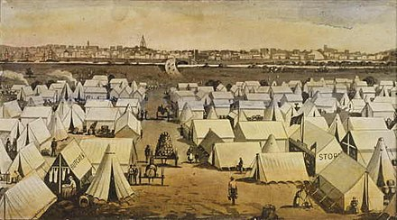 "South Melbourne's ""Canvas Town"" provided temporary accommodation for the thousands of migrants who arrived each week during the 1850s gold rush. Canvas town south melbourne victoria 1850s.jpg"
