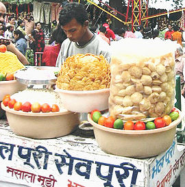 Bhel puri is a popular snack often sold on the roadside