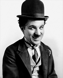 "Chaplin in his costume as ""the Tramp"""