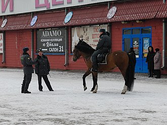 Crime in Russia - Russian police on a street in Cherkizovskaya, Moscow.