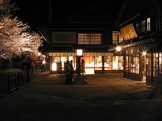 Lighting - Illuminated cherry blossoms, light from the shop windows, and Japanese lantern at night in Ise, Mie, Japan