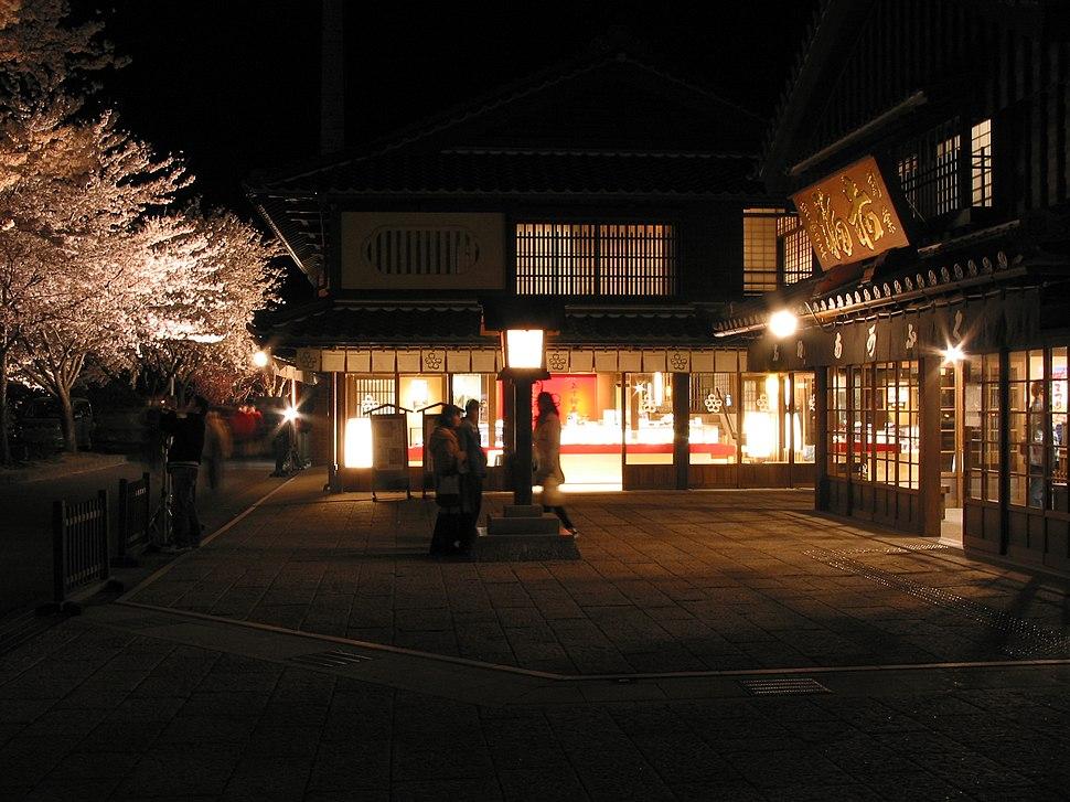 Cherry blossoms with Isuzu-Chaya and Akafuku store at Night
